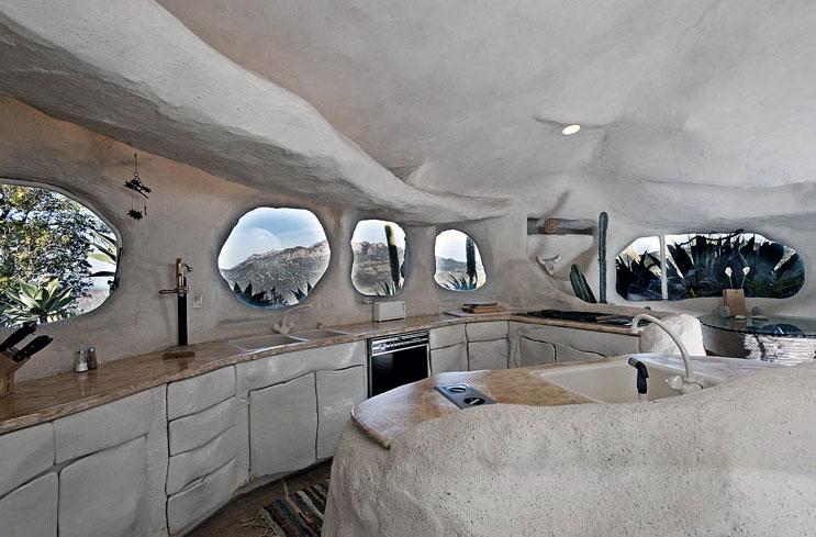 Creative-Flintstone-Style-House-Cave-Rock-Kitchen-Round-Windows-Design